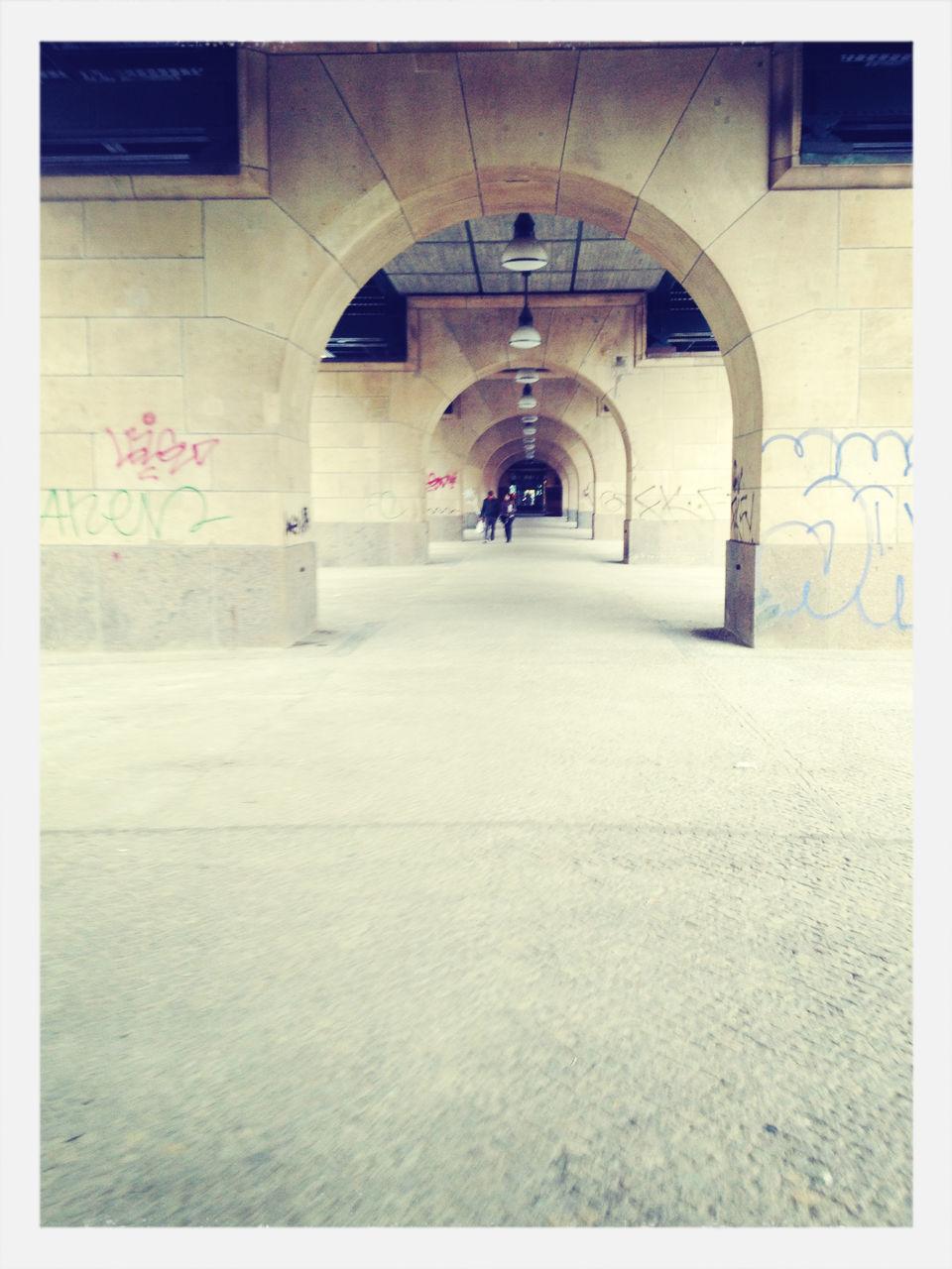 People walking in archway