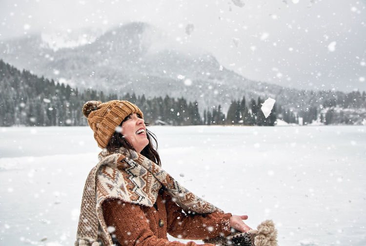 Young woman having fun in winter. snow, outdoors, happy.