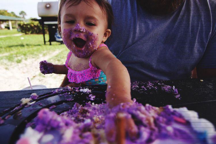 Little girl smashing cake