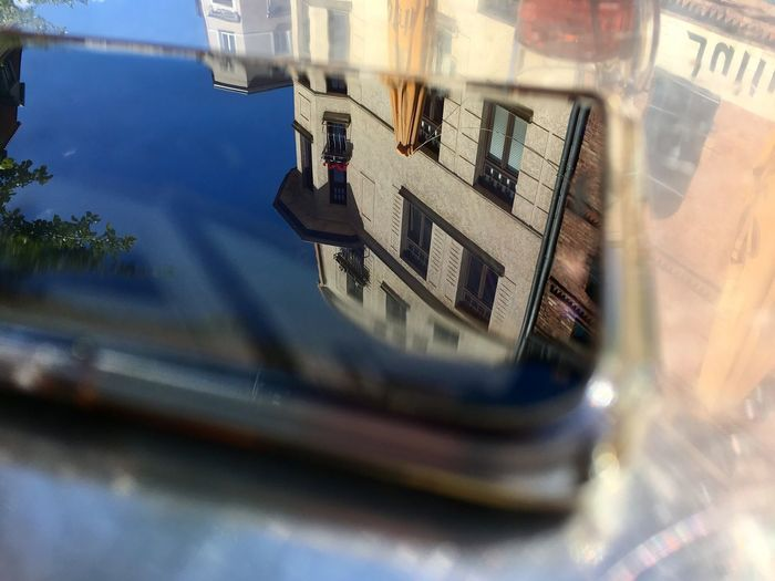 Reflect on the phone Reflection Building Exterior No People Selective Focus Architecture Built Structure Nature Day Outdoors Building Technology Glass - Material Focus On Background Close-up Window My Best Photo