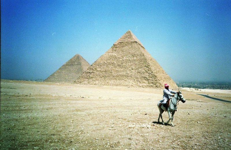 Cairo pyramids horse rider Pyramid Travel Destinations Desert History Camel Sand Transportation The Past Riding Travel Monument Domestic Animals Triangle Shape Sky Arid Climate Architecture Ancient Ancient Civilization Clear Sky Day