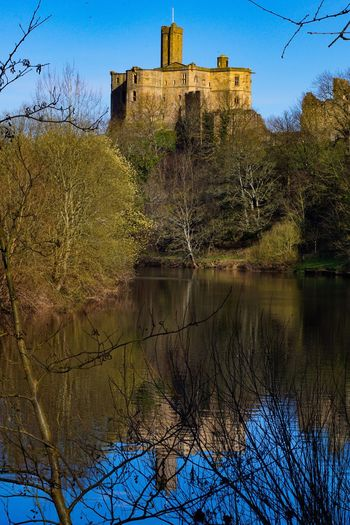 Architecture Bare Tree Building Exterior Built Structure History Castle Tree Reflection Day Water No People Outdoors Branch Nature Sky The Great Outdoors - 2017 EyeEm Awards Warkworth Northumberland Warkworth Castle