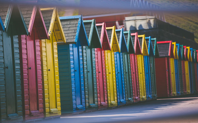 beach chalet Whitby Yorkshire Architecture Arrangement Beach Chalet Beach Huts Choice Close-up Collection Creativity Day Education In A Row Indoors  Large Group Of Objects Multi Colored No People Order Shelf Side By Side Stack Still Life Variation