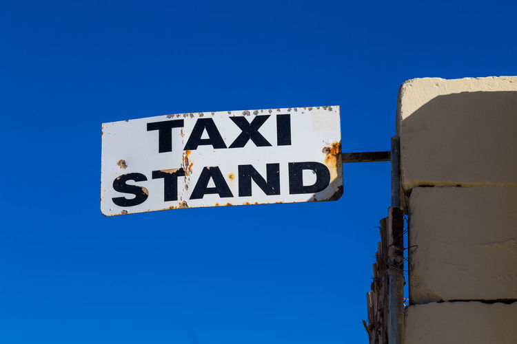 Taxi stand Blue Text Sign Clear Sky Sky Information Guidance Information Sign Road Rules