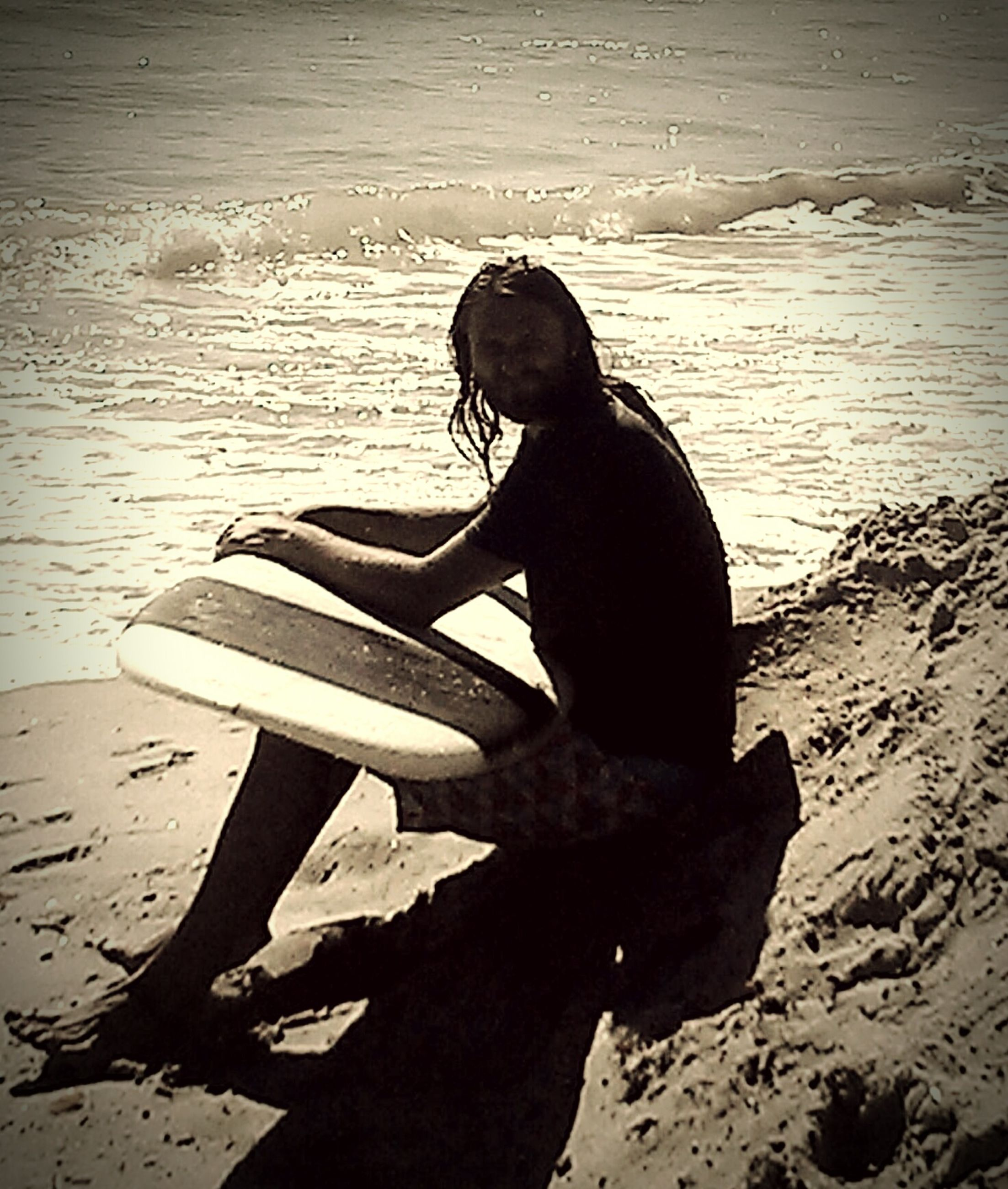 shadow, sunlight, sand, beach, full length, lifestyles, wood - material, day, leisure activity, outdoors, high angle view, shore, standing, sitting, side view, rear view, nature, water