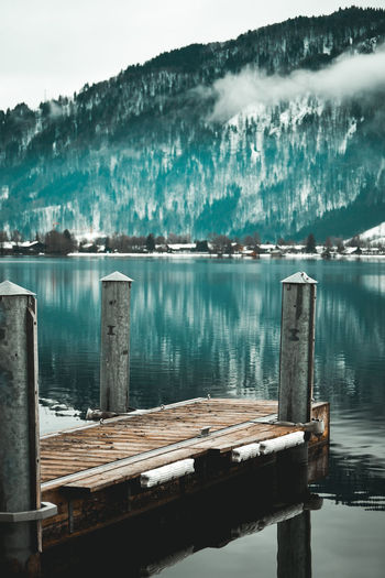 Lake Water Wood - Material Lake Nature No People Day Beauty In Nature Reflection Tranquility Scenics - Nature Post Tranquil Scene Outdoors Wooden Post Pier Built Structure Non-urban Scene Architecture Footbridge Landing Stage Winter Cold Temperature Winter Lake Lake View Lakeview