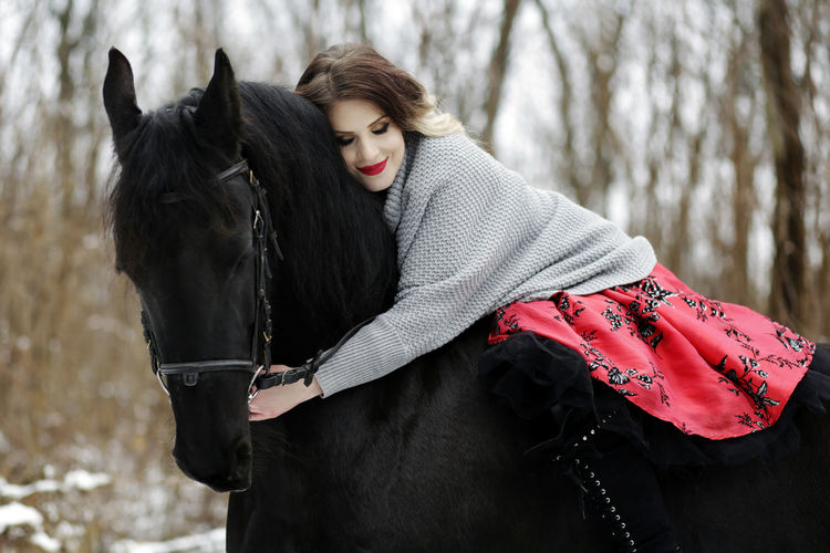 Beautiful Woman Black Color Cold Temperature Domestic Animals Horse Horse Photography  Horse Riding Horseback Riding Leisure Activity Lifestyles Livestock One Animal One Person Outdoors Real People Warm Clothing Winter Young Adult Young Women