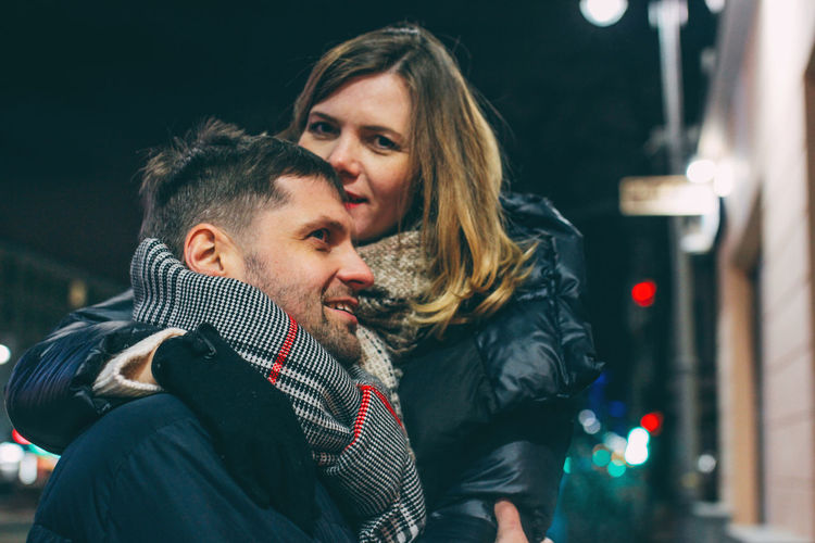 Real couple in love, winter romance in the city Two People Young Adult Young Men Togetherness Portrait Women Men Young Women Love Emotion Adult Positive Emotion Headshot Couple - Relationship Night Winter Real People Smiling Leisure Activity Warm Clothing Scarf