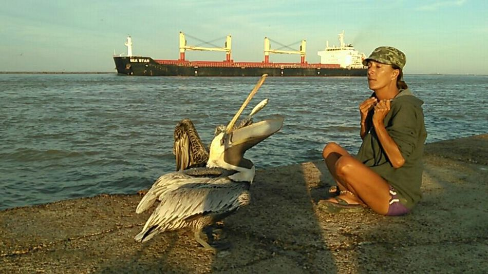 That's Me and Molly The Pelican and her Friend Eating Mullet