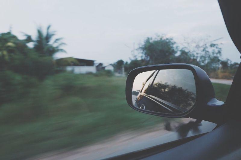 Side-View Mirror Seen Through Glass Window