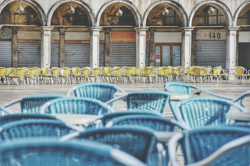 Streetphotography Venice Street Square Urban City Seat Chair Arch In A Row Architecture Building Exterior Built Structure Colonnade Outdoor Cafe Place Street Scene Destination