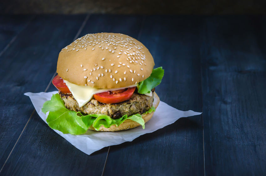Bun Burger Close-up Day Fast Food Food Food And Drink Freshness Hamburger Indoors  Lettuce Meat No People Paper Ready-to-eat Sesame Take Out Food Tomato Unhealthy Eating Vegetable