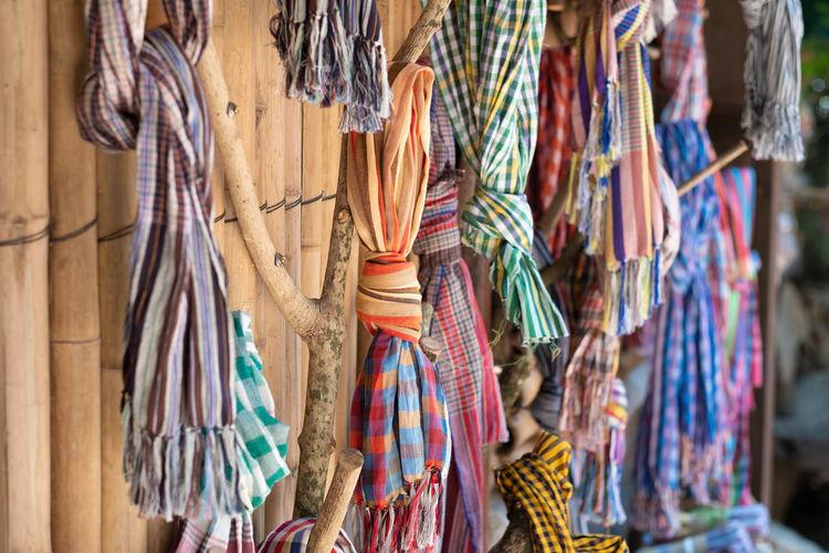 Clothes hanging at market stal