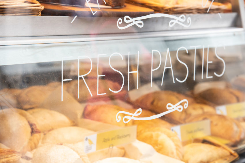 where would we be if there would be no pasties? Baked Close-up Communication Food And Drink For Sale Freshness Glass - Material Indulgence No People Pasties Retail  Retail Display Still Life Store Temptation Text Transparent