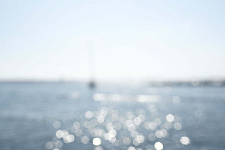 dreamy ocean. Glitter Summertime Beauty In Nature Blue Bokeh Bright Copy Space Day Dreamy Glittering Horizon Over Water Land Motion Nature No People Ocean Outdoors Scenics - Nature Sea Sky Sunlight Sunny Tranquil Scene Tranquility Water
