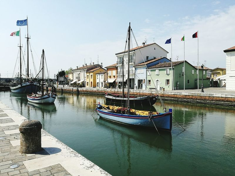 Romagnamia Porto Canale -Cesenatico Piadinaromagnola Nautical Vessel Water Harbor Moored Reflection No People Sea Outdoors Day Building Exterior Commercial Dock Beach Architecture Travel Destinations Sky Sailing Ship City Tall Ship Nature