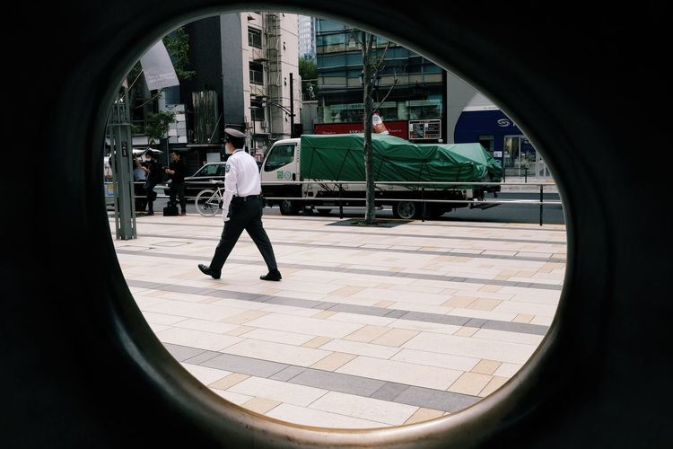 Adult Architecture Building Building Exterior Built Structure Business Business Person Circle City Day Full Length Men Nature on the move One Person Outdoors Rear View Walking Window