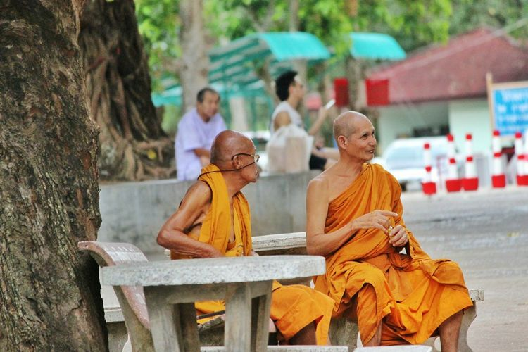 Monks Relaxing On Seat