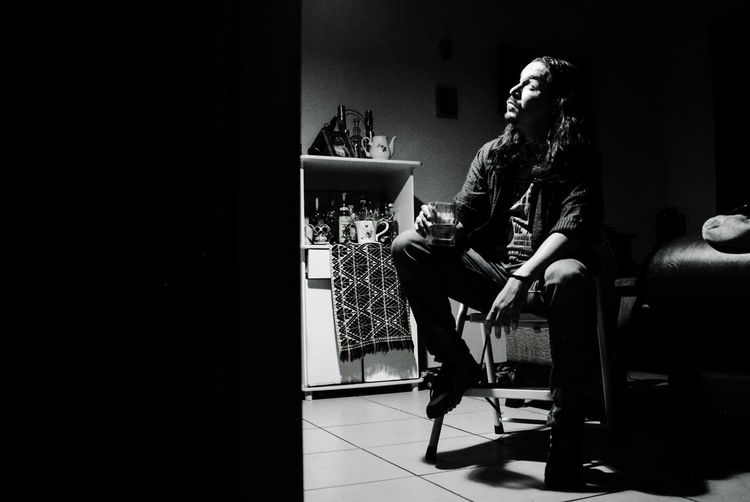 una mas y ya One More Drink Costa Rica Heredia, Costa Rica Black And White Monochrome Nightphotography Blackandwhite Glass Long Hair Alone Time Musician Full Length Home Interior Candid Sitting