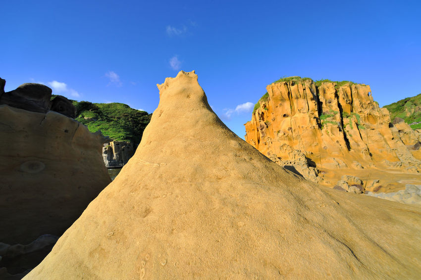 Geological landscape of blue sky, Taiwan Keelung Hepingdao Park, strange rock shapes. Natural Rock Taiwan Beauty In Nature Blue Sky Coastal Day Geology Keelung Landscape Mountain Nature No People Outdoors Park Peace Island Peaceful Scenics Seaside Sky Travel Destinations