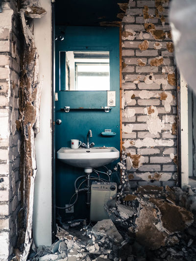 Abandoned Window No People Architecture Bathroom Sink Day Entrance Door Domestic Bathroom Wall - Building Feature Building Outdoors Wall Damaged Weathered Old Domestic Room Run-down Deterioration Reconstruction Building Site