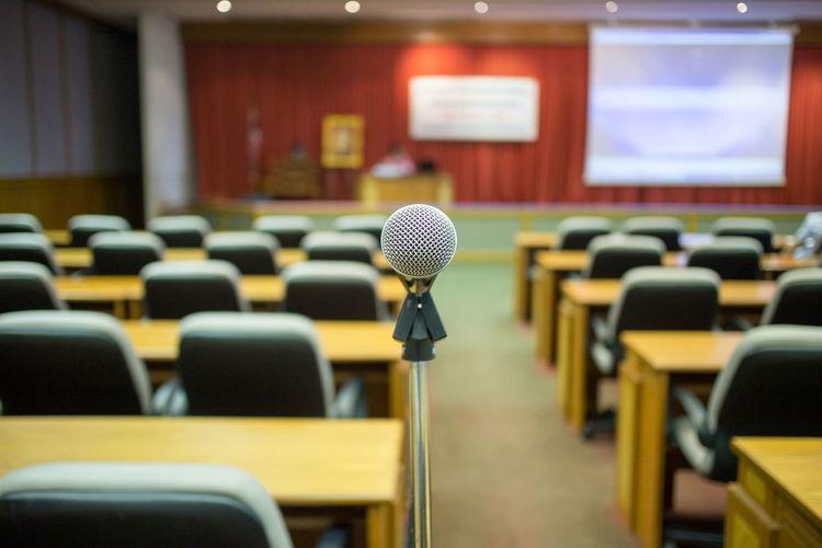 Close-up of microphone in empty auditorium