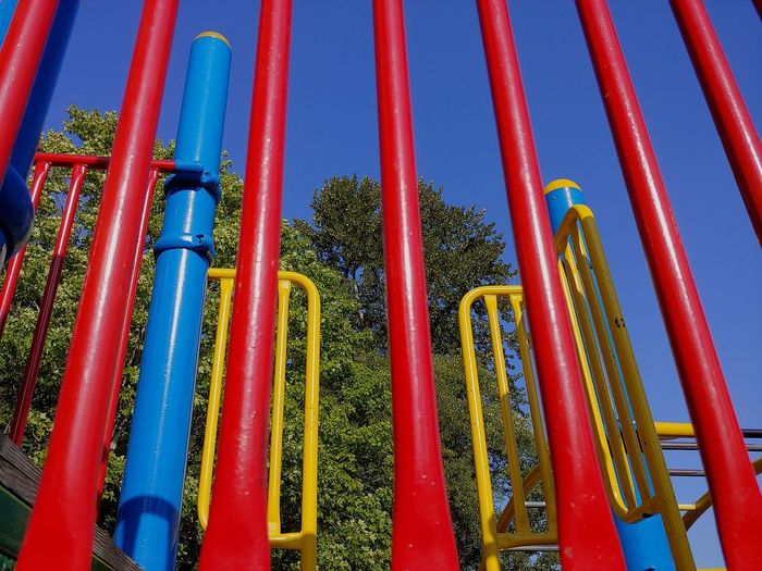 Low angle view of multi colored metallic structure in park