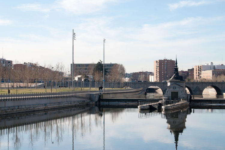 Bridge over river with buildings in background