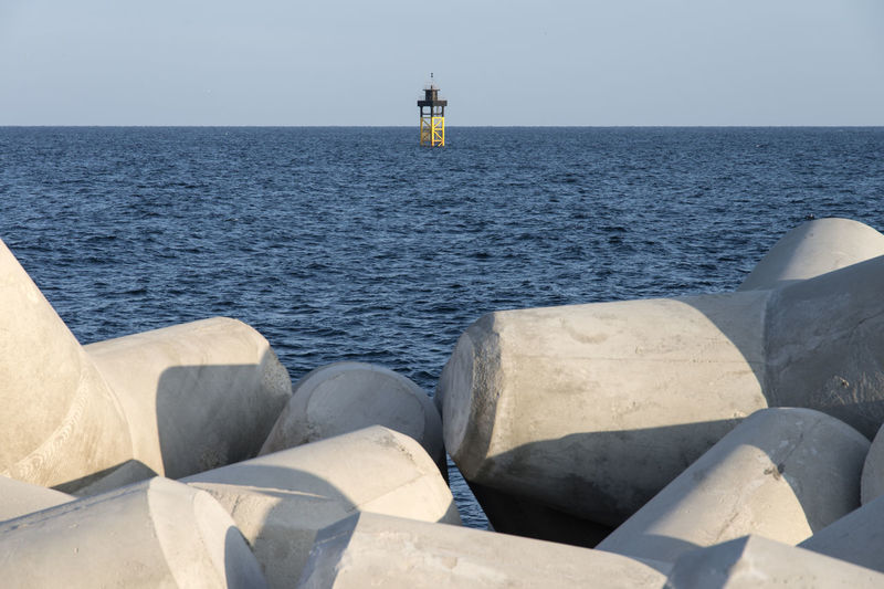 Breakwater and lighthouse in Dongmyeong Port, Sokcho City, South Korea Beauty In Nature Breakwater Business Finance And Industry Day Horizon Over Water Lighthouse Nature No People Outdoors Sea Seaside Seawall Tranquility Water