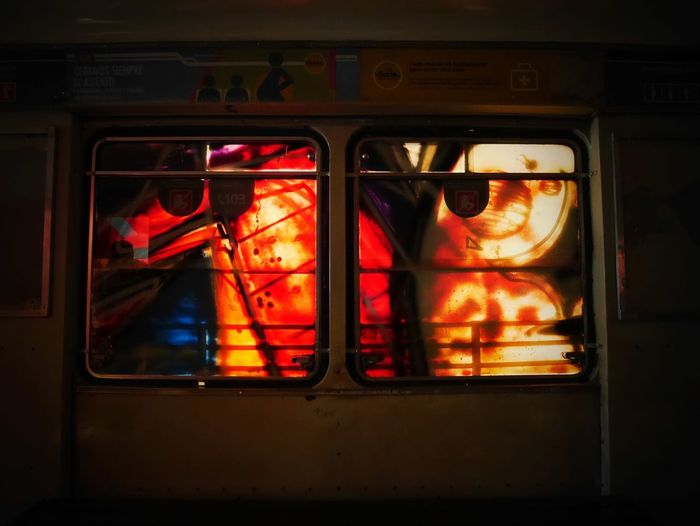 Glass - Material No People Window Mode Of Transportation Red Illuminated Transportation Orange Color Outdoors Architecture Transparent Communication Close-up Reflection Train Sign Household Equipment Food And Drink Text Subway Train
