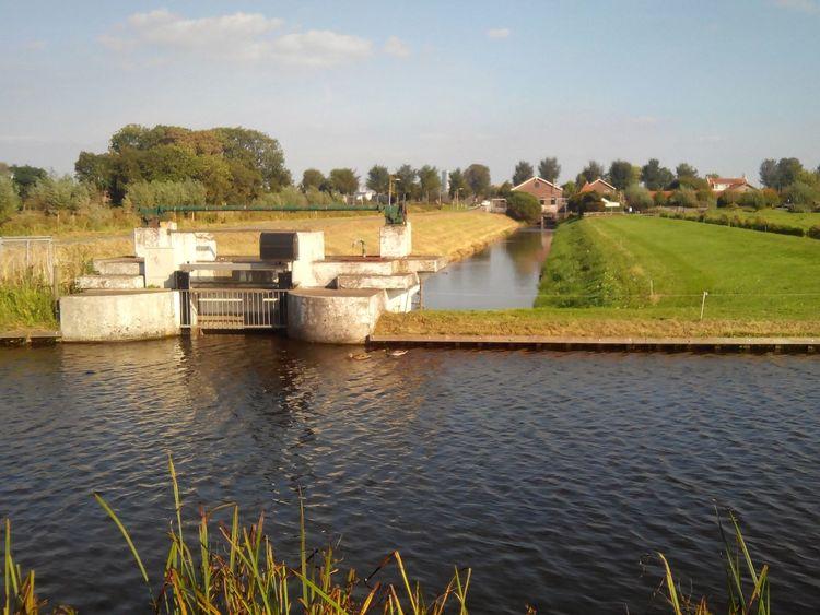 Man Made Structure Man Made Landscape Water Under Water going to a Pump House River Amstel Ouderkerk Polderlandschap Middelland Amsterdam