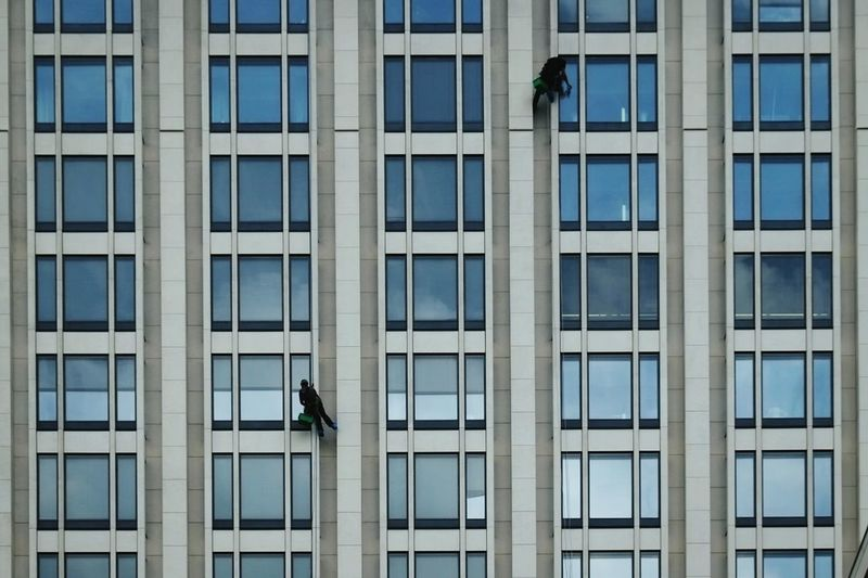 Window washers working at modern building