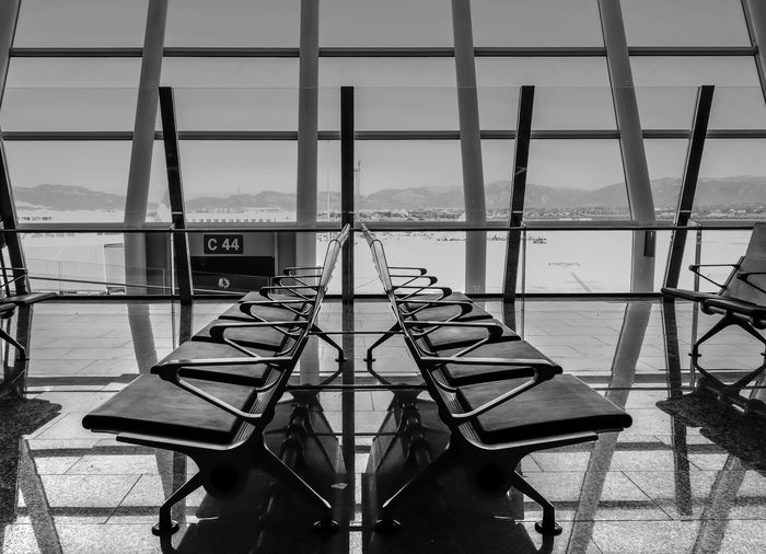 Empty Seats At Airport Lobby