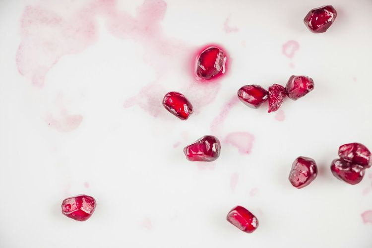 High angle view of pomegranate seeds in plate