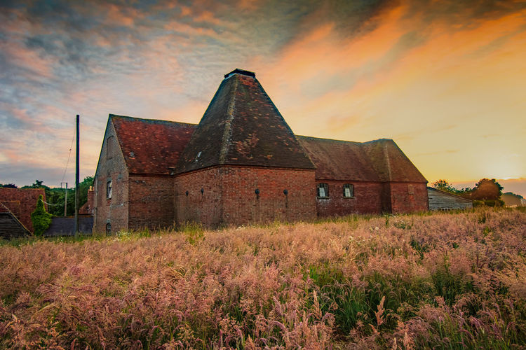 Oast House, Garden Of England, Kent, England. Architecture Sky Built Structure Nature No People Plant Hops Beer Brewing Iconic Buildings Vivid International Getty Images EyeEm Gallery Travel Destinations Tourism Sunrise Countryside Rural Scene History Building Exterior Old Cloud - Sky Abandoned The Past Land Field Sunset Building Obsolete Run-down Grass Weathered Ruined Ancient Civilization