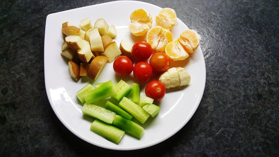High angle view of chopped fruits in plate