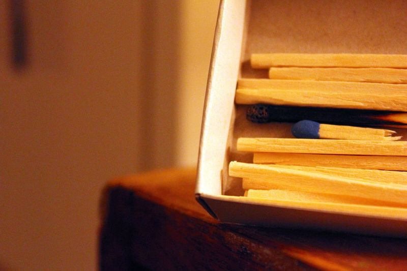 Close-Up Of Matchsticks In Box On Table