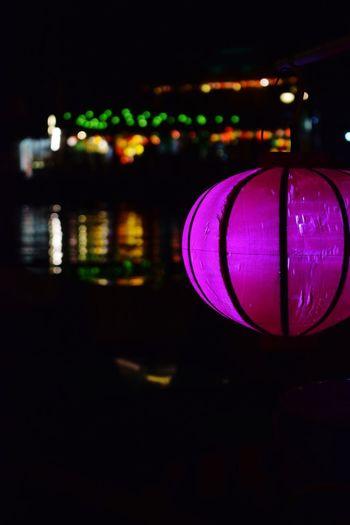 Close-up of illuminated lantern against sky at night