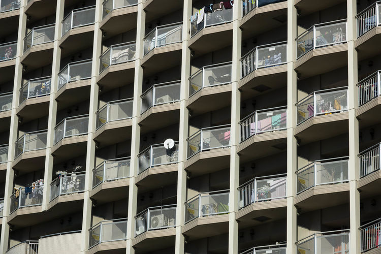 balcony Apartment Architecture Backgrounds Balcony Building Building Exterior Building Feature Built Structure City Day Full Frame In A Row Low Angle View Modern No People Outdoors Pattern Repetition Residential District Sunlight Window