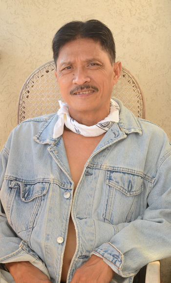 Adult Adults Only Casual Clothing Day Denim Denim Jacket Fashion Front View Handkerchief Happiness Indoors  Lifestyles Looking At Camera Mature Adult Men Mustache One Man Only One Person People Portrait Real People Sitting Smile Smiling Style The Portraitist - 2017 EyeEm Awards