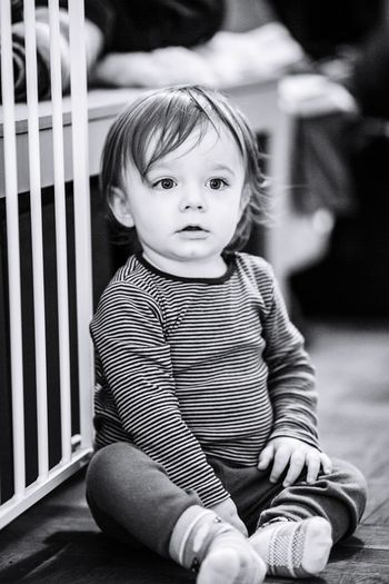 Cute baby boy sitting at home