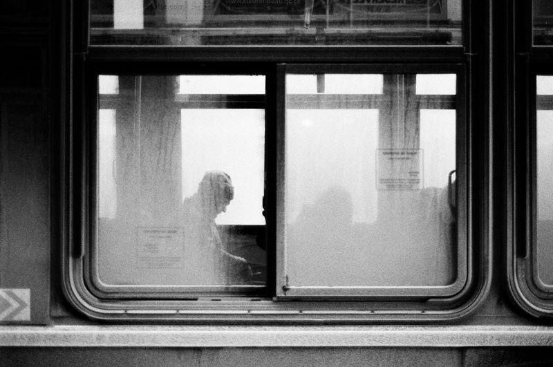 Man seen through window