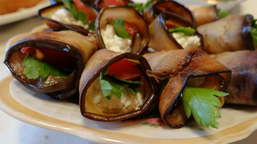 Close-Up Of Eggplant Rolls On Plate