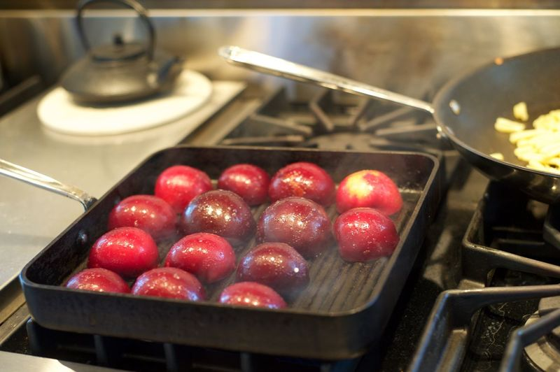 High Angle View Of Roasted Plums In Cooking Utensil On Stove