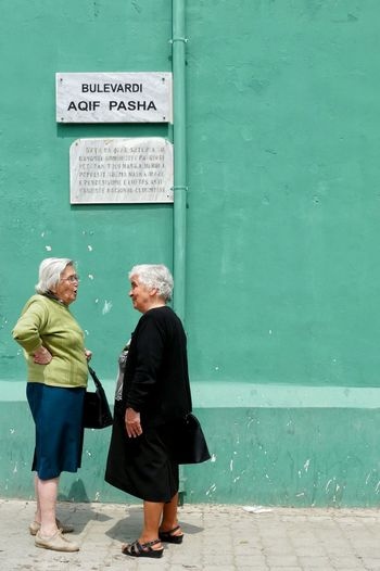 Elbasan Albania Street Photography Street The Photojournalist - 2016 EyeEm Awards Old Women Talking Chat People People Watching The Street Photographer - 2016 EyeEm Awards Traveling Travel Painted Wall Original Experiences Color Of Life Color Palette People And Places My Year My View Uniqueness Women Around The World Art Is Everywhere EyeEm Diversity Investing In Quality Of Life Connected By Travel Be. Ready. An Eye For Travel This Is Aging