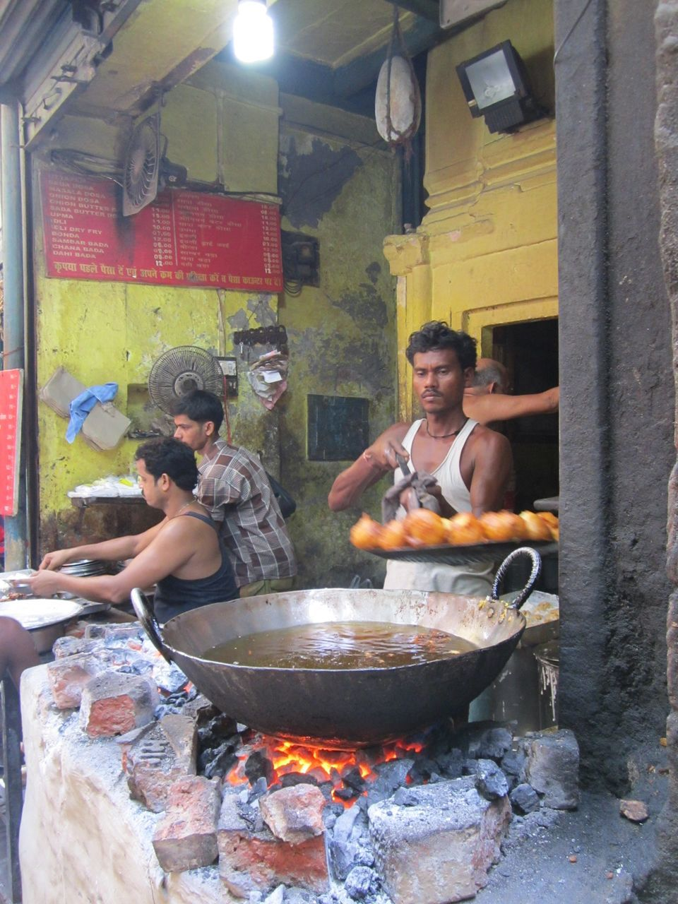 real people, preparation, built structure, leisure activity, burning, food and drink, food, lifestyles, togetherness, architecture, flame, day, men, indoors, young women, young adult, people