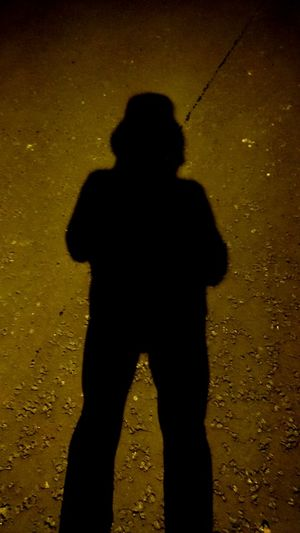 Shadow Focus On Shadow Silhouette One Person Mystery Yellow Adult Only Men Adults Only People Spooky Standing Horror One Man Only Men Night Halloween Outdoors Young Adult
