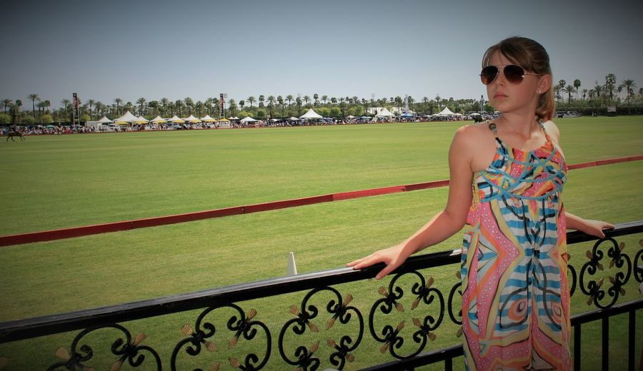 A girl enjoying the Polo Matches Beauty Casual Clothing Classy Day Elegant Elementary Age Girl Green Color Leisure Activity Lifestyle Lifestyles Looking Outdoors Polo Polo Field Standing The Good Life Tourism Vacation