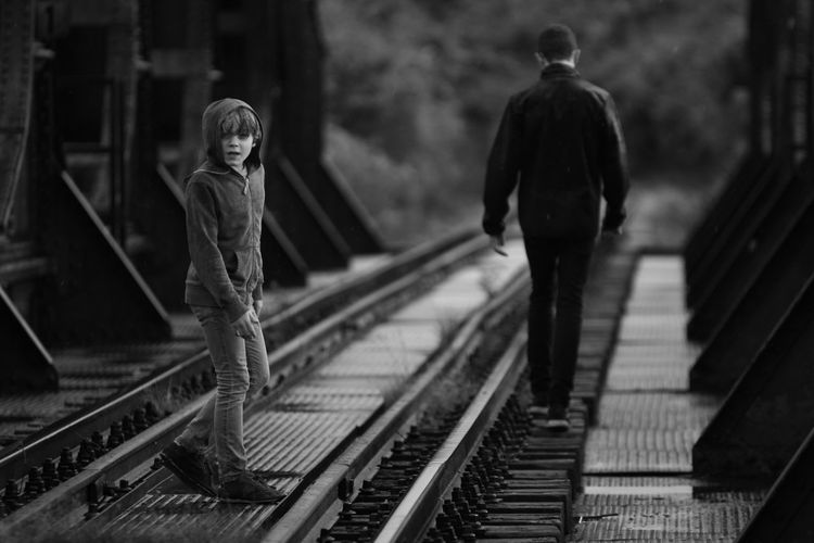 Brothers On Railroad Track