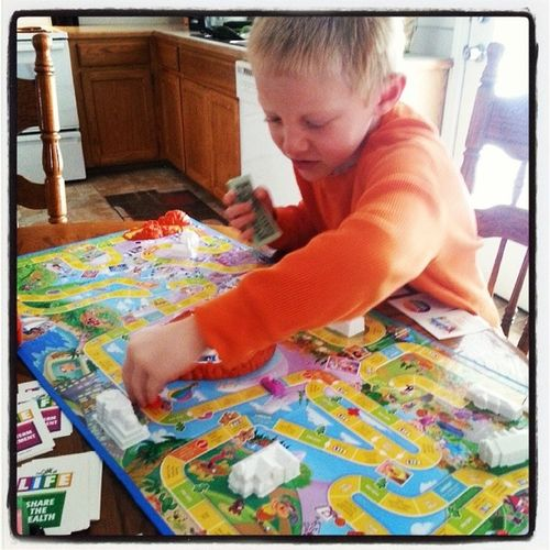 Playing life with lil man Life Gameoflife Hisfavorite Hesgood rich family familytime boardgames earlymorningfun laughing hescute imhisfavorite